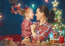 Mom and daughter near the Christmas tree Stock Photography