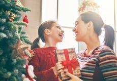 Mom and daughter near Christmas tree Stock Image
