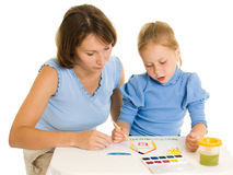 Mom and daughter paint colors. royalty free stock photo