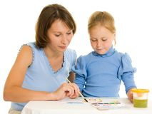 Mom and daughter paint colors. Royalty Free Stock Photography