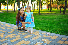 Mom and daughter painted on the pavement Stock Photo