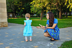 Mom and daughter painted on the pavement Royalty Free Stock Photography