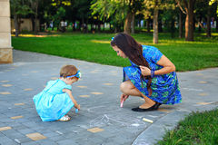 Mom and daughter painted on the pavement Stock Images