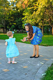 Mom and daughter painted on the pavement Stock Photography