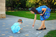 Mom and daughter painted on the pavement Royalty Free Stock Images
