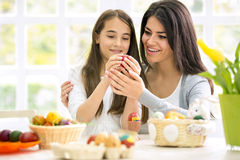 Mom and  daughter painting Easter eggs Stock Photography