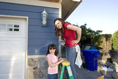 Mom and Daughter Painting a House - Horizontal Stock Image