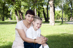 Mom and daughter in park. The portrait of the daughter and mother in the park Royalty Free Stock Photos