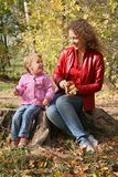 Mom and daughter in park stock photos