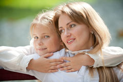 Mom and daughter on a park bench Royalty Free Stock Photos