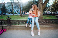 Mom and daughter in the park. Mom and daughter are having fun in the park Royalty Free Stock Images