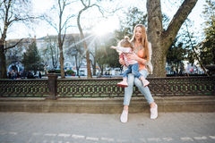 Mom and daughter in the park. Mom and daughter are having fun in the park Royalty Free Stock Photography