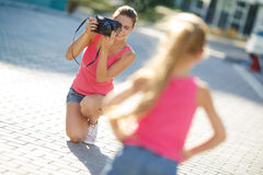 Mom daughter photographed on a street in the city Royalty Free Stock Photography