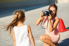 Mom daughter photographed on a street in the city Stock Images