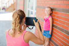 Mom daughter photographed on a street in the city Royalty Free Stock Photos