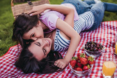 Mom and daughter on picnic Royalty Free Stock Photos