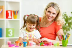 Mom and daughter play colorful clay toy Royalty Free Stock Photos