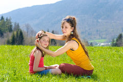 Mom and daughter play with flowers Stock Image