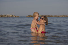 Mom and daughter play happy at sea Royalty Free Stock Photos