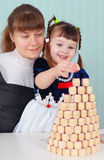 Mom and daughter play - to build a tower Stock Image
