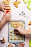 Mom and daughter are playing bakery. Prepare homemade cookies with dough berries royalty free stock photos
