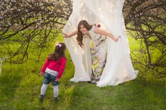 Mom and daughter are playing, hugging and smiling outdoors, family, motherhood, child Royalty Free Stock Images