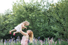 Mom and daughter are playing in nature royalty free stock photography