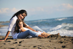 Mom and daughter portrait on beach Royalty Free Stock Photo