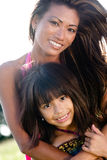 Mom and daughter posing Stock Photos