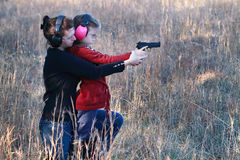 Mom and Daughter Practicing Shooting stock image
