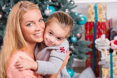 Mom and daughter preparing for Christmas Stock Images