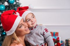 Mom and daughter preparing for Christmas Stock Photography