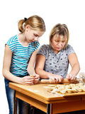 Mom and daughter preparing dumplings isolated Stock Photos
