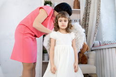 Mom and daughter are preparing for the holiday Stock Images