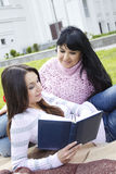 Mom and daughter reading a book Stock Photography
