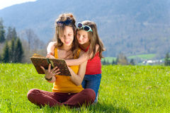 Mom and daughter reading a book Stock Image