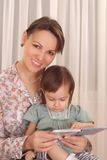 Mom and daughter reading Royalty Free Stock Photo