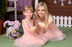 Mom and daughter holding in his hands chickens royalty free stock photo