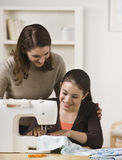 Mom And Daughter Sewing Royalty Free Stock Photo