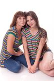 Mom and daughter sit in an embrace. Family photo. Different emotions. royalty free stock photos