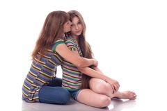 Mom and daughter sit in an embrace. Family photo. Different emotions. Stock Image
