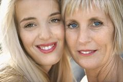 Mom and daughter smiling. Royalty Free Stock Images
