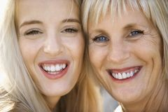 Mom and daughter smiling. Stock Photo