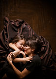 Mom and daughter. Smiling and hugging Royalty Free Stock Photos