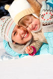 Mom and daughter in snow Royalty Free Stock Photos