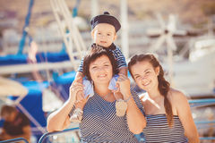 Mom, daughter and son rest in the summer on the beach Royalty Free Stock Images