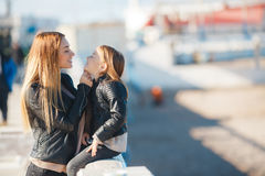 Mom and daughter spend time walking near the sea Stock Images