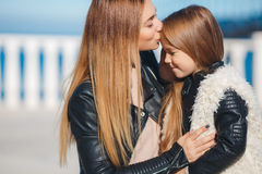 Mom and daughter spend time walking near the sea Royalty Free Stock Photography