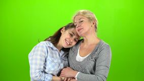 Mom and daughter on talking . Green screen. Mom and daughter stand and talking on various topics. Green screen stock video footage
