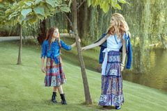 Mom and daughter are standing by the lake. Royalty Free Stock Photography